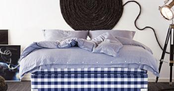 cabeceira de cama feita com cora grossa preta