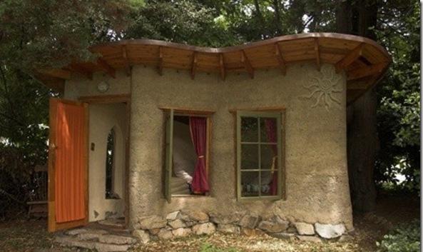 fachada de uma casa construída de barro